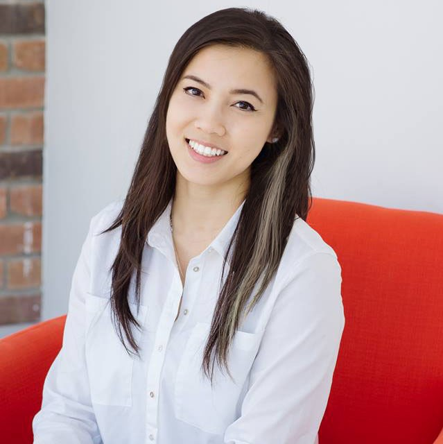 Kimberly Luu's headshot, sitting in the iconic red HackerYou chair